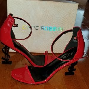 Red patent money sign heels
